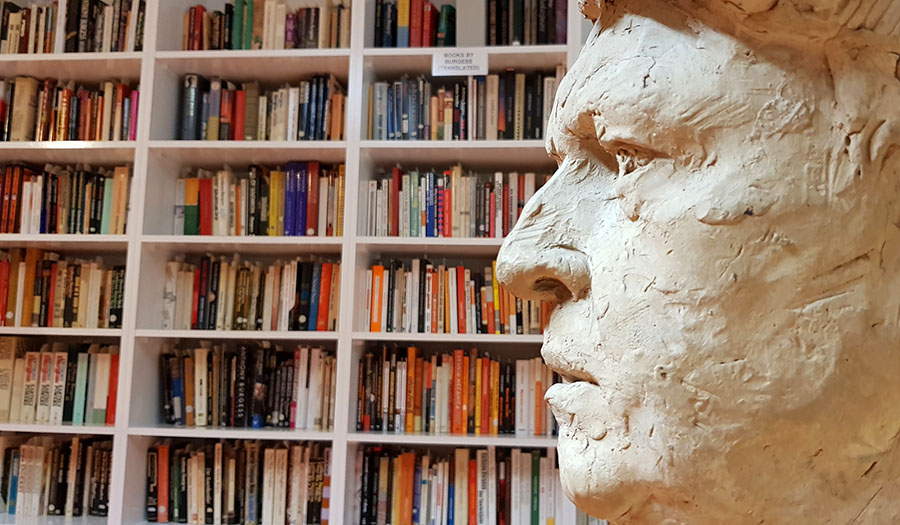 The Milton Hebald bust of Anthony Burgess amid Anthony Burgess's book collection