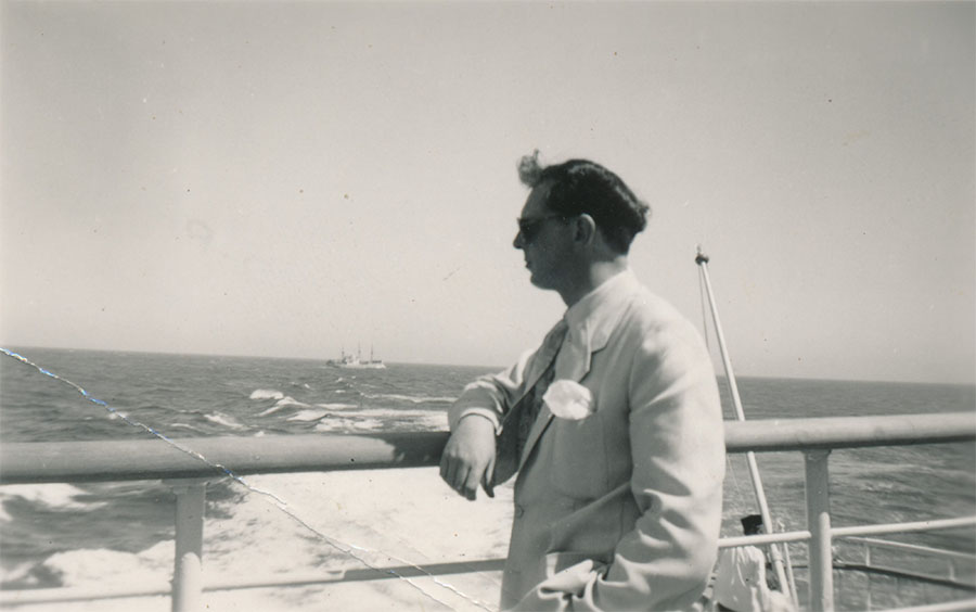 Anthony Burgess on a boat looking out to sea
