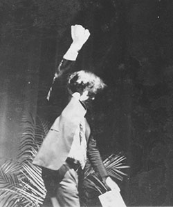 Burgess with arm raised