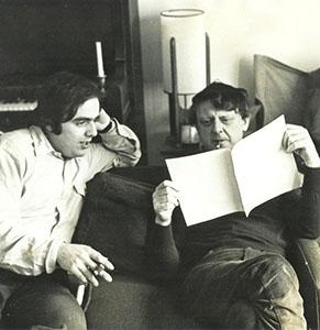 Burgess inspecting a manuscript
