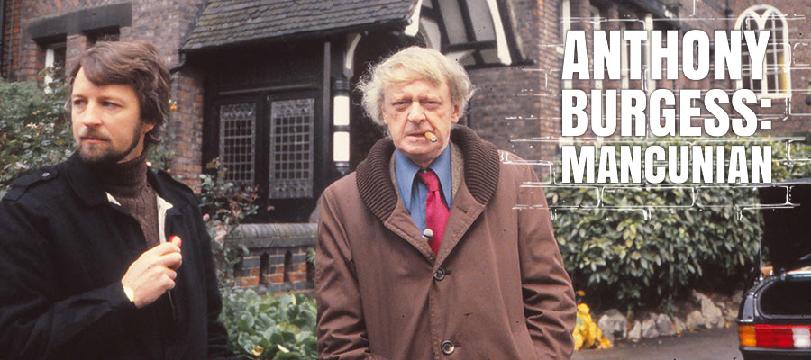 Anthony Burgess looking into the camera outside a house in Manchester