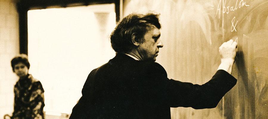 Anthony Burgess writing on chalkboard
